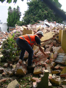 Bricks being gathered from the rubble of no. 10 - 28 January
